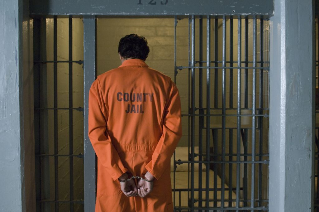 Man In Prison - iStock_000059585366_Medium