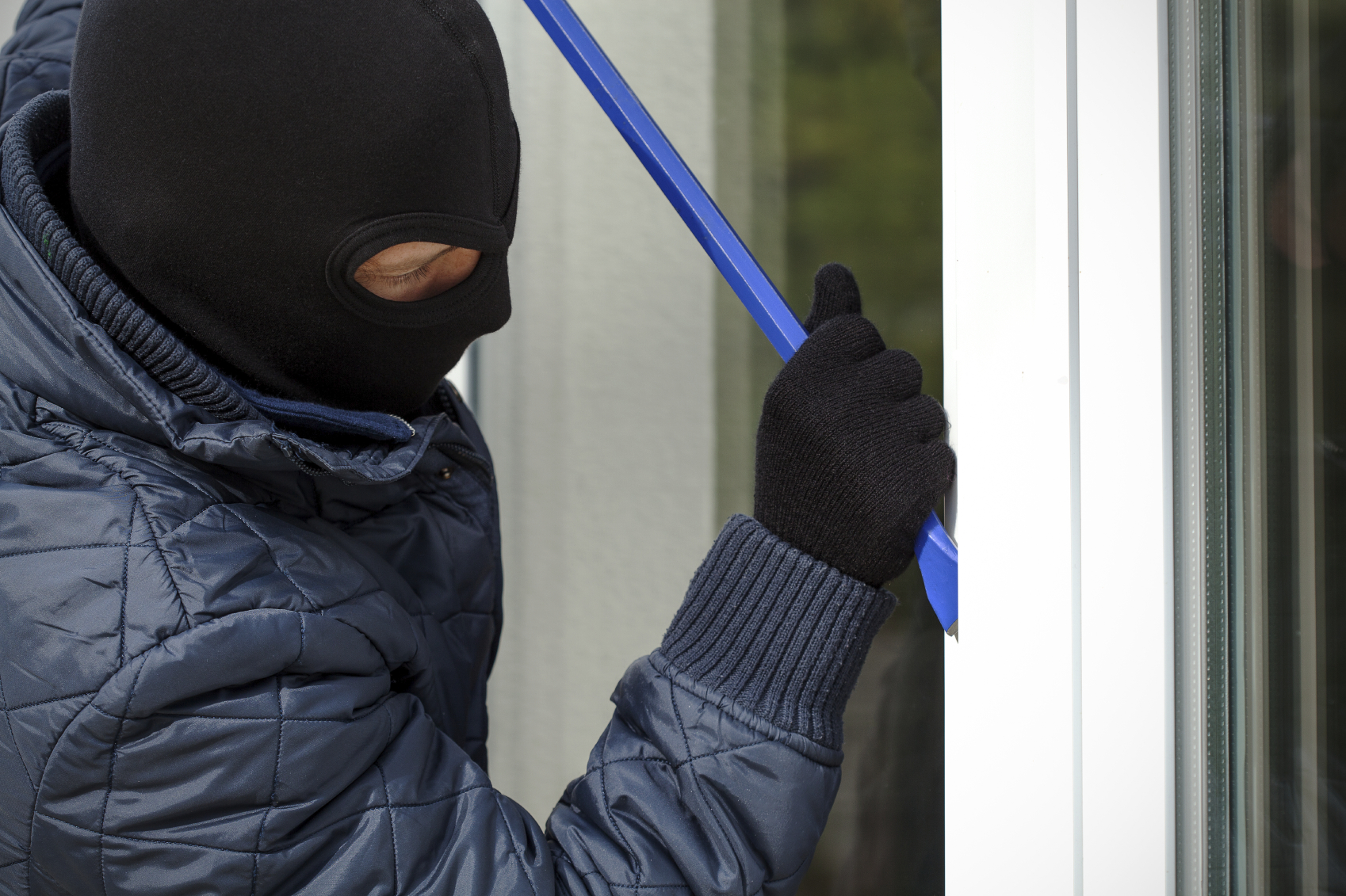 Burglar Forcing Window with Crowbar