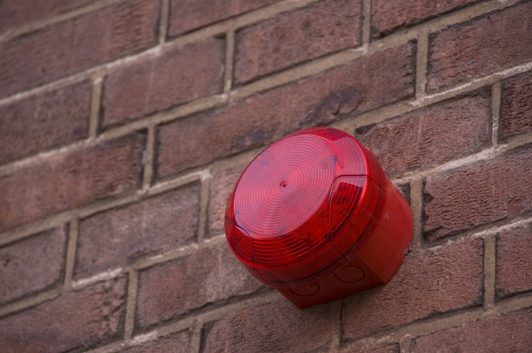 Red Alarm on Exterior Wall of Building