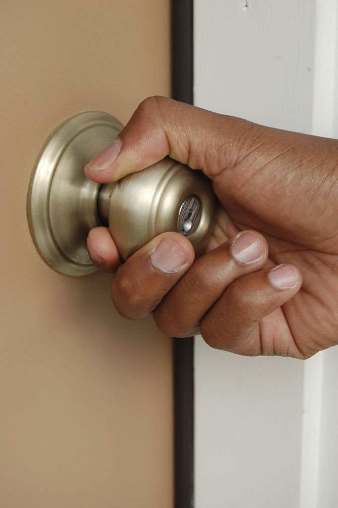 Door Knob and Hand - iStock_000003522378_Large