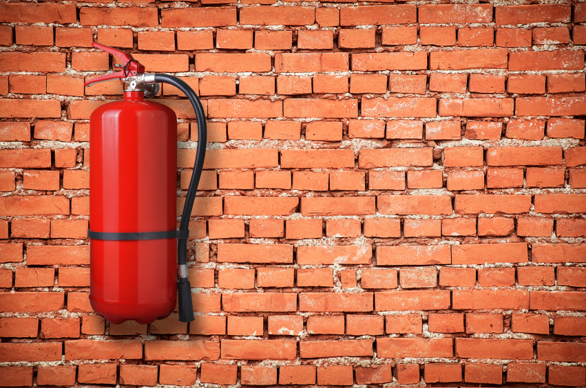 fire extinguisher on brick wall