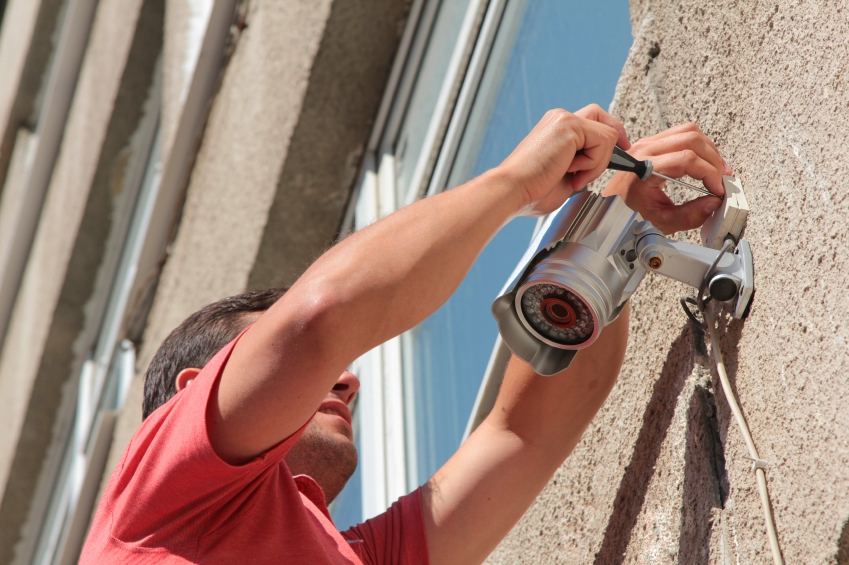 Man Installing CCTV