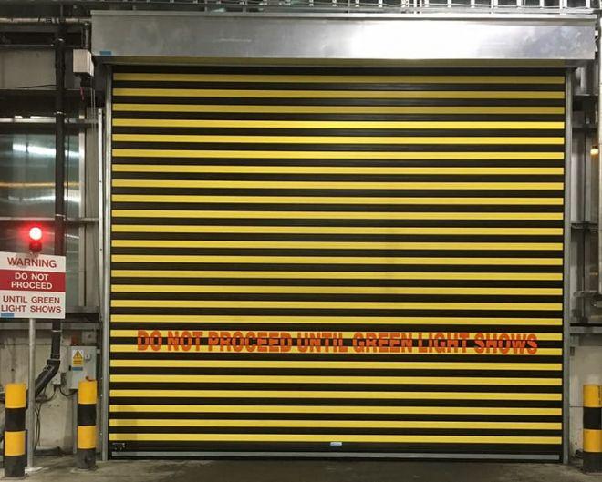 Insulated Roller Shutter-Alternate Black-Yellow-Signage